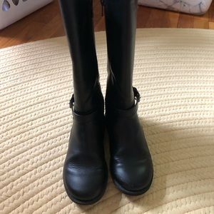 Little girl black riding boots.
